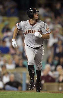 LOS ANGELES, CA - APRIL 01:  Brandon Belt #9 of the San Francisco Giants trots to first base after hitting a three-run homerun against the Los Angeles Dodgers in the fourth inning at Dodger Stadium on April 1, 2011 in Los Angeles, California.  (Photo by J