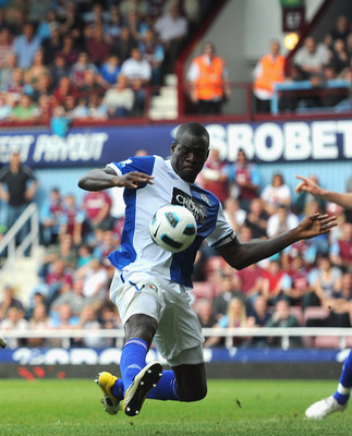 LONDON, ENGLAND - MAY 07:  Carlton Cole of West Ham United has his shot blocked by Christopher Samba of Blackburn Rovers during the Barclays Premier League match between West Ham United and Blackburn Rovers at the Boleyn Ground on May 7, 2011 in London, E
