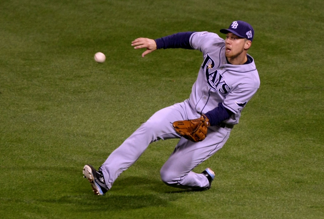 PHILADELPHIA - OCTOBER 26:  Ben Zobrist #18 of the Tampa Bay Rays makes a sliding catch in the outfield against the Philadelphia Phillies during game four of the 2008 MLB World Series on October 26, 2008 at Citizens Bank Park in Philadelphia, Pennsylvania