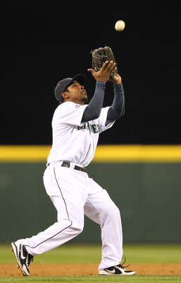 SEATTLE - MAY 04:  Third baseman Chone Figgins #9 of the Seattle Mariners catches a pop fly against the Texas Rangers at Safeco Field on May 4, 2011 in Seattle, Washington. (Photo by Otto Greule Jr/Getty Images)