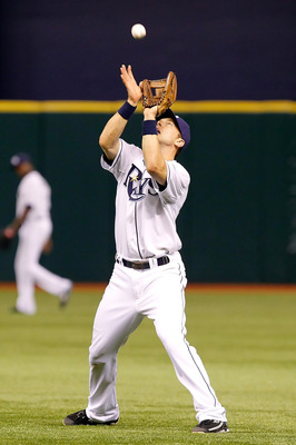 ST. PETERSBURG, FL - APRIL 05:  Infielder Ben Zobrist #18 of the Tampa Bay Rays catches a fly ball against the Los Angeles Angels of Anaheim during the game at Tropicana Field on April 5, 2011 in St. Petersburg, Florida.  (Photo by J. Meric/Getty Images)