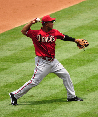 MIAMI GARDENS, FL - JUNE 12:  Melvin Mora #4 of the Arizona Diamondback throws onto first for and out against the Florida Marlins at Sun Life Stadium on June 12, 2011 in Miami Gardens, Florida.  (Photo by Jason Arnold/Getty Images)