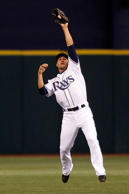 ST. PETERSBURG - APRIL 09:  Infielder Sean Rodriguez #1 of the Tampa Bay Rays catches a line drive against the New York Yankees during the game at Tropicana Field on April 9, 2010 in St. Petersburg, Florida.  (Photo by J. Meric/Getty Images)