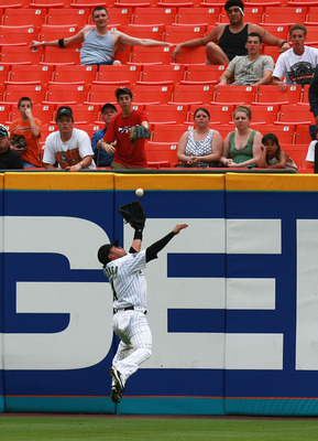 MIAMI - JUNE 12:  Center fielder Alfredo Amezaga #4 of the Florida Marlins makes a leaping catch in the second inning against the Cleveland Indians during interleague play at Dolphin Stadium on June 12, 2007 in Miami, Florida.  (Photo by Doug Benc/Getty I