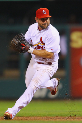 ST. LOUIS, MO - JULY 7: Nick Punto #8 of the St. Louis Cardinals throws to first base against the Arizona Diamondbacks at Busch Stadium on July 7, 2011 in St. Louis, Missouri.  (Photo by Dilip Vishwanat/Getty Images)