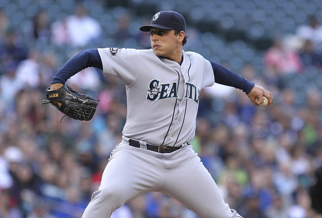 SEATTLE - JUNE 25:  Starting pitcher Jason Vargas #38 of the Seattle Mariners pitches against the Florida Marlins at Safeco Field on June 25, 2011 in Seattle, Washington. (Photo by Otto Greule Jr/Getty Images)