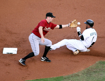 MIAMI GARDENS, FL - JULY 09:  Emilio Bonifacio #1 of the Florida Marlins steals second base against Jeff Keppinger #8 of the Houston Astros at Sun Life Stadium on July 9, 2011 in Miami Gardens, Florida.  (Photo by Marc Serota/Getty Images)
