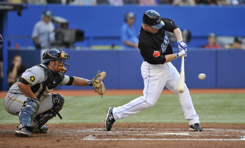 TORONTO, CANADA - JUNE 30:  Aaron Hill #2 of the Toronto Blue Jays bats in front of Michael McKenry #55 of the Pittsburgh Pirates during MLB interleague game action June 30, 2011 at Rogers Centre in Toronto, Ontario, Canada. (Photo by Brad White/Getty Ima