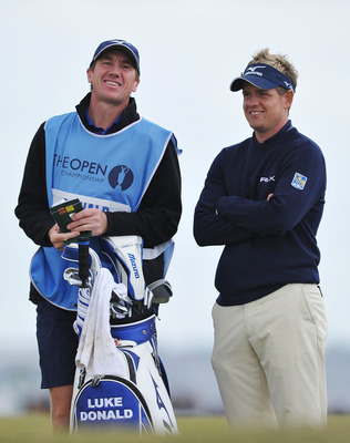 SANDWICH, ENGLAND - JULY 13:  Luke Donald of England chats with his caddie John McClaren during the final practice round during The Open Championship at Royal St. George's on July 13, 2011 in Sandwich, England. The 140th Open begins on July 14, 2011..  (P