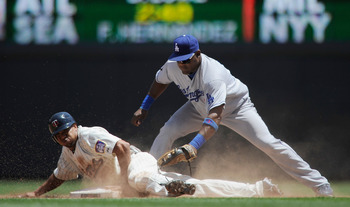 MINNEAPOLIS, MN - JUNE 29: Ben Revere #11 of the Minnesota Twins steals second under Juan Uribe #5 of the Los Angeles Dodgers tag in the fifth inning on June 29, 2011 at Target Field in Minneapolis, Minnesota. The Twins defeated the Dodgers 1-0. (Photo by