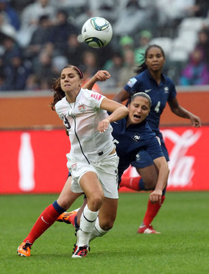 MOENCHENGLADBACH, GERMANY - JULY 13:  Ophelie Meilleroux (L) of France and Alex Morgan (R) of USA battle for the ball during the FIFA Women's World Cup 2011 Semi Final match between France and USA at Borussia-Park on July 13, 2011 in Moenchengladbach, Ger