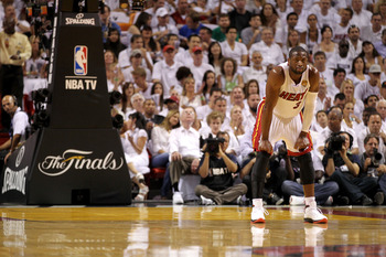 MIAMI, FL - JUNE 12:  Dwyane Wade #3 of the Miami Heat looks on against the Dallas Mavericks in Game Six of the 2011 NBA Finals at American Airlines Arena on June 12, 2011 in Miami, Florida. NOTE TO USER: User expressly acknowledges and agrees that, by do