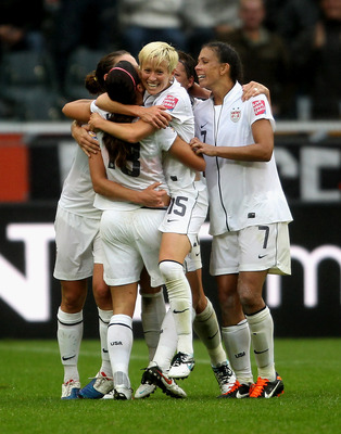 MOENCHENGLADBACH, GERMANY - JULY 13:  The USA team celebrate after scoring their second goal during the FIFA Women's World Cup 2011 Semi Final match between France and USA at Borussia Park on July 13, 2011 in Moenchengladbach, Germany.  (Photo by Scott He