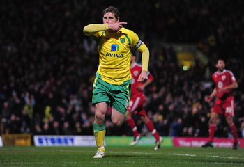 NORWICH, ENGLAND - MARCH 14:  Grant Holt celebrates his first goal during the npower Chapionship match between Norwich City and Bristol City at Carrow Road on March 14, 2011 in Norwich, England.  (Photo by Jamie McDonald/Getty Images)