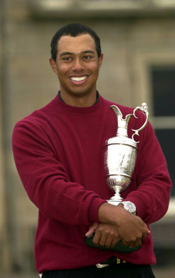 373807 04: Tiger Woods holds the claret jug after his victory in the British Open Championships at the Old Course, St. Andrews, Scotland July 23, 2000. (Photo by Stephen Munday/Getty Images)