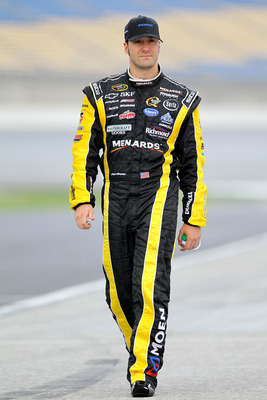 SPARTA, KY - JULY 08:  Paul Menard, driver of the #27 Sylvania/Menards Chevrolet, walks on the grid during qualifying for the NASCAR Sprint Cup Series Quaker State 400 at Kentucky Speedway on July 8, 2011 in Sparta, Kentucky.  (Photo by Andy Lyons/Getty I