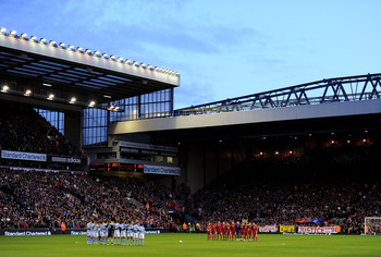 LIVERPOOL, ENGLAND - APRIL 11:  The Liverpool and Manchester City players acknowledge a minutes silence in memory of the victims of the Hillsborough disaster prior to the Barclays Premier League match between Liverpool and Manchester City at Anfield on Ap