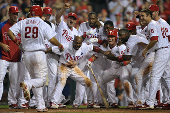 PHILADELPHIA, PA - JULY 08: The Philadelphia Phillies wait at home plate for teammate Raul Ibanez #29 after he hit a walk-off home run in the bottom of the 10th inning to beat the Atlanta Braves 3-2 at Citizens Bank Park on July 8, 2011 in Philadelphia, P