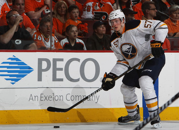 PHILADELPHIA, PA - APRIL 26:  Tyler Myers #57 of the Buffalo Sabres controls the puck against the Philadelphia Flyers in Game Seven of the Eastern Conference Quarterfinals during the 2011 NHL Stanley Cup Playoffs at Wells Fargo Center on April 26, 2011 in