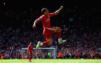 LIVERPOOL, ENGLAND - MAY 01:  Maxi Rodriguez of Liverpool leaps into the air to celebrate after scoring the first goal during the Barclays Premier League match between Liverpool  and Newcastle United at Anfield on May 1, 2011 in Liverpool, England.  (Phot