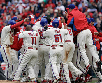 PHILADELPHIA, PA - APRIL 01:  Members of the Philadelphia Phillies celebrate after defeating the Houston Astros 5-4 during opening day at Citizens Bank Park on April 1, 2011 in Philadelphia, Pennsylvania.  (Photo by Rob Carr/Getty Images)