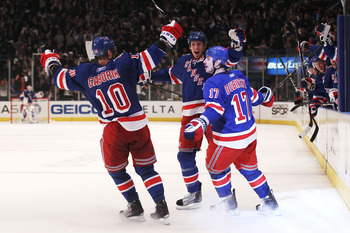 NEW YORK, NY - APRIL 20:  (L-R) Marian Gaborik #10, Marc Staal #18 and Brandon Dubinsky #17 of the New York Rangers celebrate after Dubinsky scored a second period goal against the Washington Capitals in Game Four of the Eastern Conference Quarterfinals d