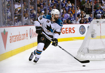 VANCOUVER, CANADA - MAY 24:  Joe Thornton #19 of the San Jose Sharks looks to break out of the defensive zone against the San Jose Sharks in Game Five of the Western Conference Finals during the 2011 Stanley Cup Playoffs at Rogers Arena on May 24, 2011 in