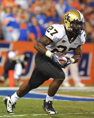 GAINESVILLE, FL - NOVEMBER 7: Running back Warren Norman #27 of the Vanderbilt Commodores rushes upfield with a kick against the Florida Gators November 7, 2009 at Ben Hill Griffin Stadium in Gainesville, Florida.  (Photo by Al Messerschmidt/Getty Images)