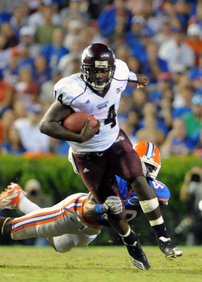 GAINESVILLE, FL - OCTOBER 16:  Quarterback Chris Relf #14 of the Mississippi State Bulldogs rushes upfield against the Florida Gators October 16, 2010 Ben Hill Griffin Stadium at Gainesville, Florida.  (Photo by Al Messerschmidt/Getty Images)