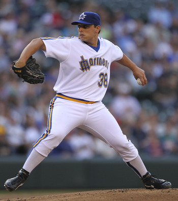 SEATTLE - JULY 01:  Starting pitcher Jason Vargas #38 of the Seattle Mariners pitches against the San Diego Padres at Safeco Field on July 1, 2011 in Seattle, Washington. (Photo by Otto Greule Jr/Getty Images)