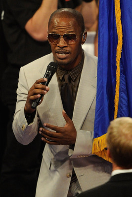 LAS VEGAS, NV - MAY 07:  Actor/singer Jamie Foxx sings 'America the Beautiful' before the Manny Pacquiao of the Philippines and Shane Mosley WBO welterweight title fight at MGM Grand Garden Arena on May 7, 2011 in Las Vegas, Nevada.  (Photo by Ethan Mille