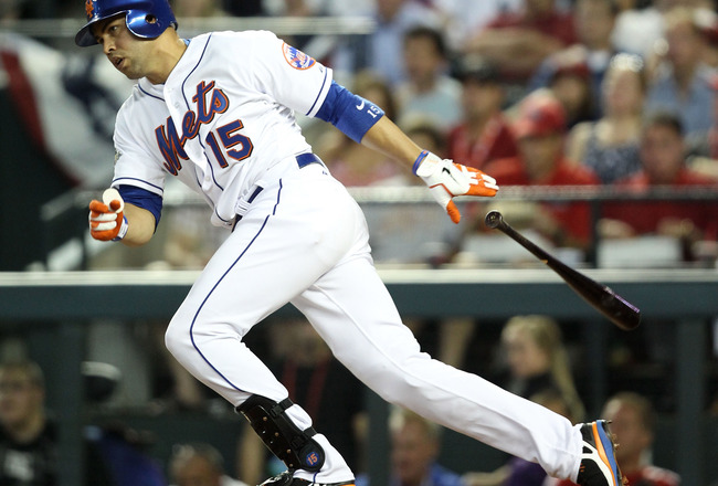 PHOENIX, AZ - JULY 12:  National League All-Star Carlos Beltran #15 of the New York Mets hits an infield single in the fourth inning of the 82nd MLB All-Star Game at Chase Field on July 12, 2011 in Phoenix, Arizona.  (Photo by Christian Petersen/Getty Ima