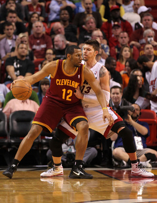MIAMI, FL - JANUARY 31: Joey Graham #12 of the Cleveland Cavaliers posts up Mike Miller #13 of the Miami Heat  during a game at American Airlines Arena on January 31, 2011 in Miami, Florida. NOTE TO USER: User expressly acknowledges and agrees that, by do