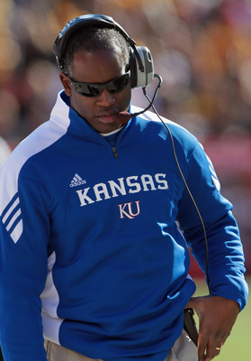 KANSAS CITY, MO - NOVEMBER 27:  Head coach Turner Gill of the Kansas Jayhawks coaches from the sidelines during the game against the Missouri Tigers on November 27, 2010 at Arrowhead Stadium in Kansas City, Missouri.  (Photo by Jamie Squire/Getty Images)