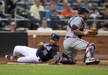 NEW YORK, NY - JUNE 03: Carlos Beltran #15 of the New York Mets slides into home after catcher Brian McCann #16 of the Atlanta Braves at Citi Field on June 3, 2011 in the Flushing neighborhood of the Queens borough of New York City.  (Photo by Nick Laham/