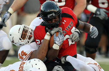 LUBBOCK, TX - SEPTEMBER 18:  Running back Eric Stephens #24 of the Texas Tech Red Raiders is tackled by Jackson Jeffcoat #44 of the Texas Longhorns at Jones AT&T Stadium on September 18, 2010 in Lubbock, Texas.  (Photo by Ronald Martinez/Getty Images)