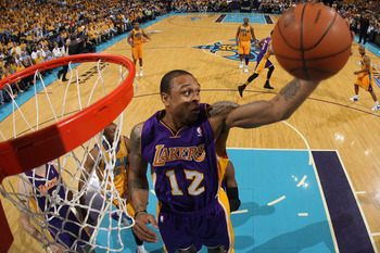 NEW ORLEANS, LA - APRIL 22:  Shannon Brown #12 of the Los Angeles Lakers grabs a rebound during the game against the New Orleans Hornets in Game Three of the Western Conference Quarterfinals in the 2011 NBA Playoffs at the New Orleans Arena  on April 22,