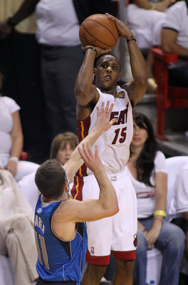 MIAMI, FL - JUNE 02:  Mario Chalmers #15 of the Miami Heat shoots over Jose Juan Barea #11 of the Dallas Mavericks in Game Two of the 2011 NBA Finals at American Airlines Arena on June 2, 2011 in Miami, Florida. NOTE TO USER: User expressly acknowledges a