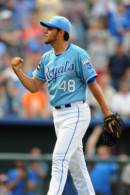KANSAS CITY, MO - JUNE 9:  Joakim Soria #48 of the Kansas City Royals celebrates following a win against the Toronto Blue Jays at Kauffman Stadium on June 9, 2011 in Kansas City, Missouri. The Royals defeated the Blue Jays 3-2. (Photo by G. Newman Lowranc