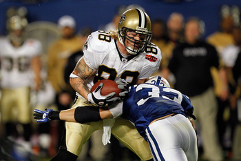 MIAMI GARDENS, FL - FEBRUARY 07: Jeremy Shockey #88 of the New Orleans Saints runs with the ball against Melvin Bullitt #33 of the Indianapolis Colts during Super Bowl XLIV on February 7, 2010 at Sun Life Stadium in Miami Gardens, Florida.  (Photo by Jona