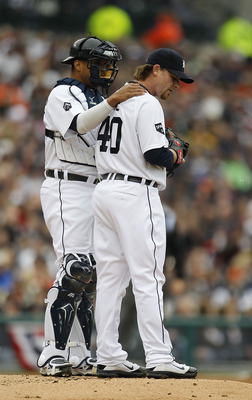 DETROIT - APRIL 09: Victor Martinez #41 of the Detroit Tigers talks with pitcher Phil Coke #40 during the second inning of the game against the Kansas City Royals at Comerica Park on April 9, 2011 in Detroit, Michigan. The Royal defeated the Tigers 3-1. (