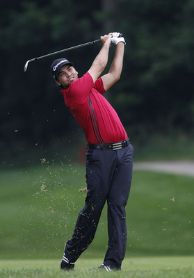 SILVIS, IL - JULY 07:  Jason Day of Australia hits a shot from the rough during the first round of the John Deere Classic at TPC Deere Run on July 7, 2011 in Silvis, Illinois.  (Photo by Michael Cohen/Getty Images)