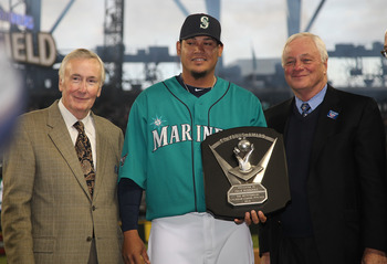 SEATTLE - APRIL 08:  Starting pitcher Felix Hernandez #34 of the Seattle Mariners is flanked by CEO Howard Lincoln (L) and COO Chuck Armstrong after receiving his American League Cy Young Award trophy prior to the Mariners' home opener against the Clevela