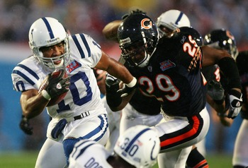 MIAMI GARDENS, FL - FEBRUARY 04:  Receiver Terrence Wilkins #10 of the Indianapolis Colts runs with the ball past Adrian Peterson #29 of the Chicago Bears during the second quarter of Super Bowl XLI on February 4, 2007 at Dolphin Stadium in Miami Gardens,