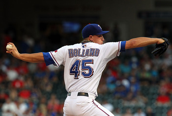 ARLINGTON, TX - JULY 02:  Pitcher Derek Holland #45 of the Texas Rangers throws against the Florida Marlins at Rangers Ballpark in Arlington on July 2, 2011 in Arlington, Texas.  (Photo by Ronald Martinez/Getty Images)