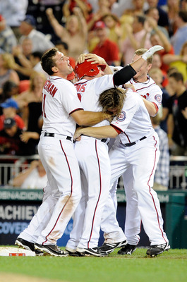 WASHINGTON, DC - JULY 01:  Matt Stairs #12 of the Washington Nationals celebrates with Ryan Zimmerman #11, Jayson Werth #28 and Brian Bixler #43 after driving in the winning run in the ninth inning against the Pittsburgh Pirates at Nationals Park on July