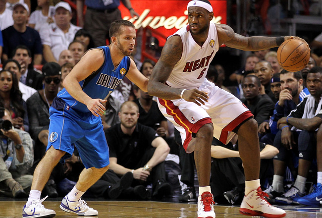 MIAMI, FL - JUNE 12:  LeBron James #6 of the Miami Heat posts up against Jose Juan Barea #11 of the Dallas Mavericks in Game Six of the 2011 NBA Finals at American Airlines Arena on June 12, 2011 in Miami, Florida. The Mavericks won 105-95. NOTE TO USER: