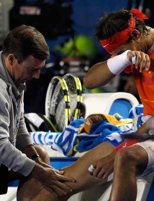 MELBOURNE, AUSTRALIA - JANUARY 26:  Rafael Nadal of Spain recieves medical attention between games in his quarterfinal match against Andy Murray of Great Britain during day nine of the 2010 Australian Open at Melbourne Park on January 26, 2010 in Melbourn