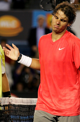 MELBOURNE, AUSTRALIA - JANUARY 26:  Rafael Nadal of Spain walks off court after losing in his quarterfinal match against David Ferrer of Spain during day ten of the 2011 Australian Open at Melbourne Park on January 26, 2011 in Melbourne, Australia.  (Phot