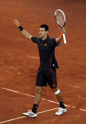 MADRID, SPAIN - MAY 08:  Novak Djokovic of Serbia celebrates at match point after defeating Rafael Nadal of Spain in the final during day nine of the Mutua Madrilena Madrid Open Tennis on May 8, 2011 in Madrid, Spain.  (Photo by Julian Finney/Getty Images